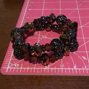 Woman's bronze tone stretch bracelet